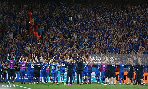 The Iceland fans applaud their fans after the UEFA EURO 2016 Round of 16 match between England and Iceland at Allianz Riviera Stadium on June 27 2016...