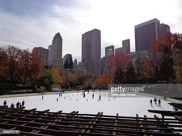 CONTENT] The iceskating rink in Central Park in New York Including ice skaters and skyline and autumn like trees
