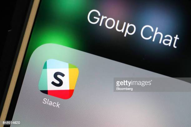 The icon for the chat service app Slack by Slack Technologies Inc sits on the screen of an Apple Inc iPhone 6 smartphone in this arranged photograph...
