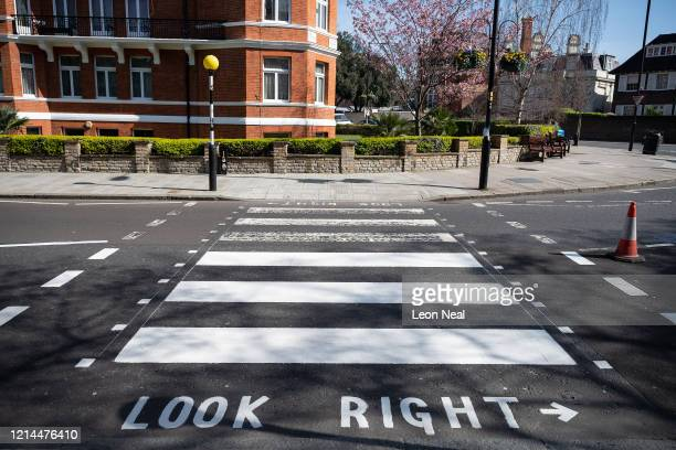 The iconic Abbey Road crossing is seen halfway through a repaint by a Highways Maintenance team as they take advantage of the COVID19 coronavirus...
