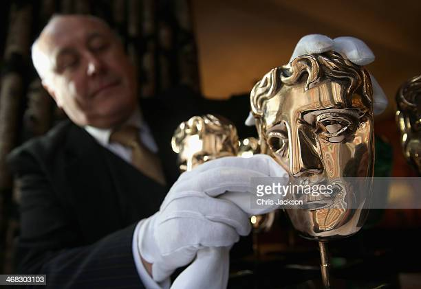 The iconic BAFTA mask awards are polished by a butler at the Savoy Hotel ahead of the British Academy Film Awards on Sunday 16th February on February...