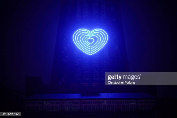 The iconic Blackpool Tower is adorned with a blue heart in honour of the British National Health Service and frontline staff who are fighting against...