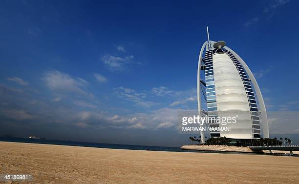 The iconic Burj alArab hotel is seen on the coast of Dubai on November 25 2013 The Emirati city is competing with Brazil's Sao Paulo the Turkish city...