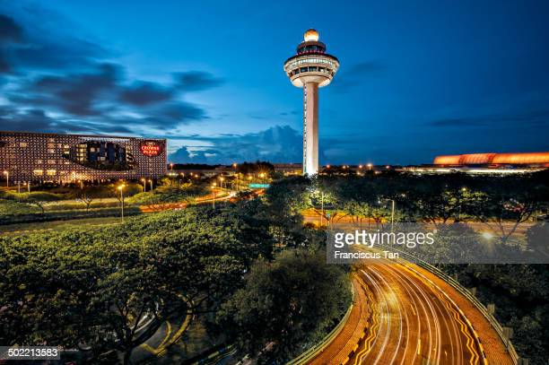 CONTENT] The iconic Changi Airport Control Tower with light trail during dusk