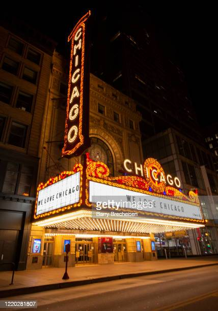 """The iconic Chicago Theater shows a sign that reads """"We Love Chicago"""" during the """"stay at home"""" order amid the COVID-19 pandemic on April 21, 2020 in..."""