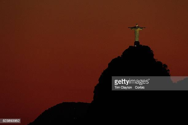The iconic Cristo Redentor Christ the Redeemer statue at sunset atop the mountain Corcovado shot from Sugar Loaf Mountain The Christ statue was voted...