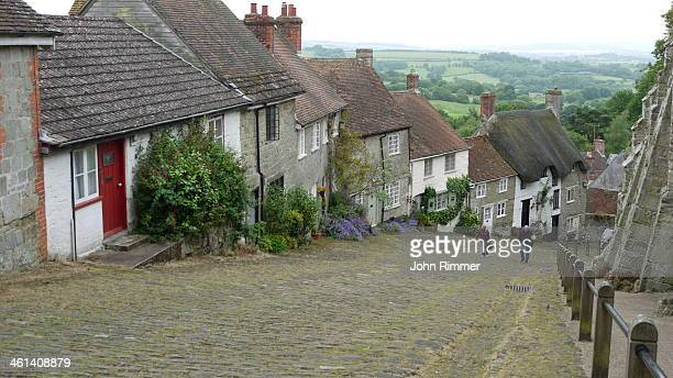 The iconic Dorset street which is a mecca for tourists wishing to see traditional English countryside.