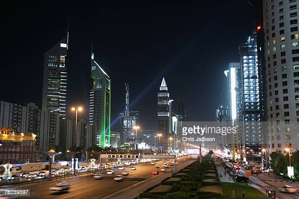 The iconic Emirates Towers dominate the skyline beside the wide boulevard of Sheikh Zayed Road on December 3 2007 in Dubai United Arab Emirates The...