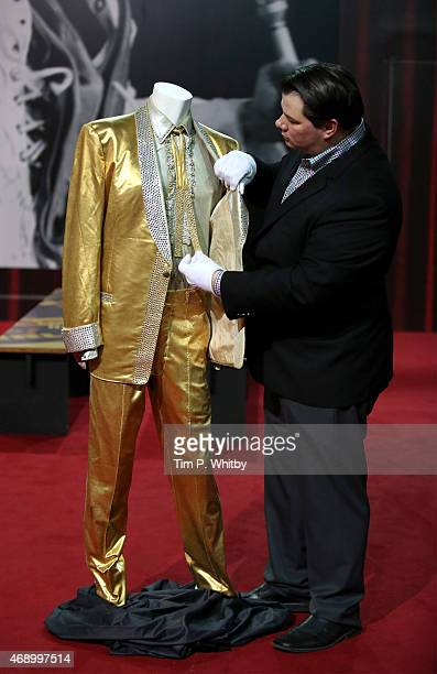 The iconic gold suit worn by Elvis Presley on the cover of his album '50000 Fans Can't Be Wrong' being inspected by Graceland director Kevin Kern at...
