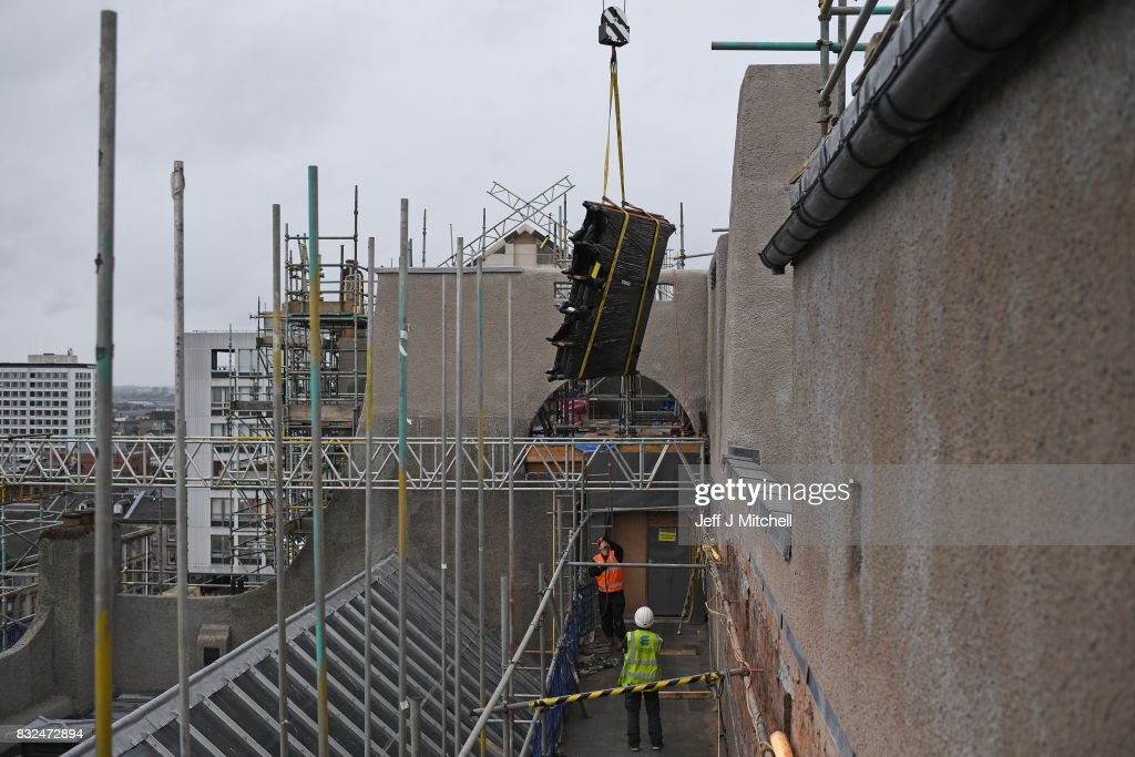 The iconic Hen Run wall and roof panels are craned in at the Glasgow School of Art Mackintosh building on August 16, 2017 in Glasgow, Scotland. Restoration of Glasgow School of Art continues, the Mackintosh building was engulfed by flames as students were preparing for their final year degree show in May 2014. Photo by Jeff J Mitchell/Getty Images)