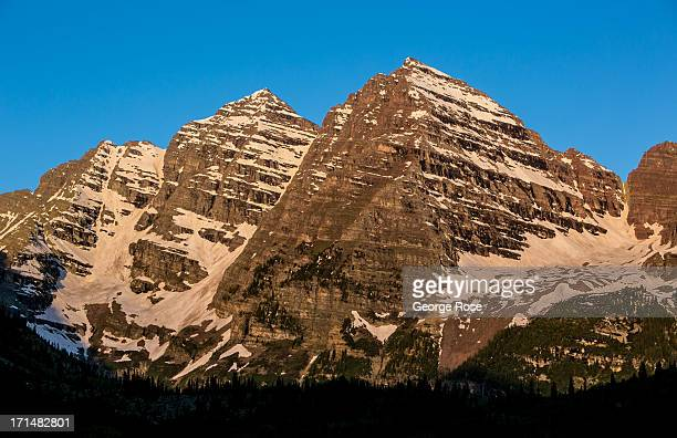 The iconic Maroon Bells light up at sunrise on June 14 near Aspen Colorado Colorado's Rocky Mountains are part of a range that extends 3000 miles...