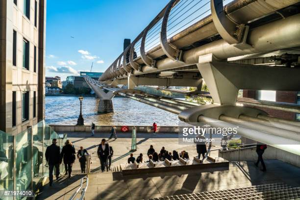 The iconic Millennium Bridge crossing the Thames River London UK