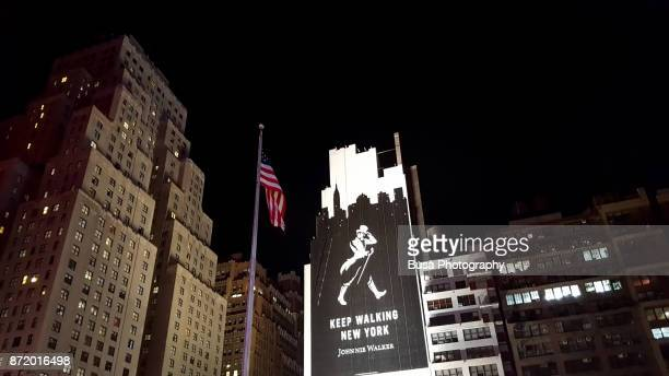 the iconic new yorker hotel at 8th avenue and 34th street in midtown manhattan at night, new york city - new yorker building stock pictures, royalty-free photos & images