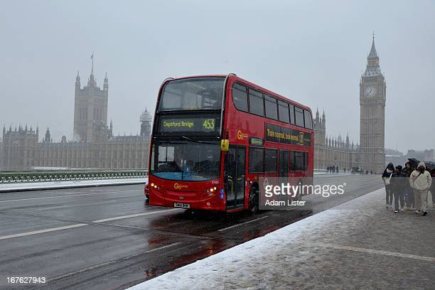 CONTENT] The iconic red London bus part of London's transport network crosses Westminster Bridge with the Houses of Parliament behind Snow lies on...