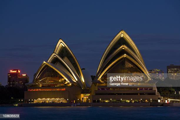 The iconic Sydney Opera House lights up after sunset on August 8 2010 Sydney AustraliaThe multiuse performing arts venue designed by Danish architect...
