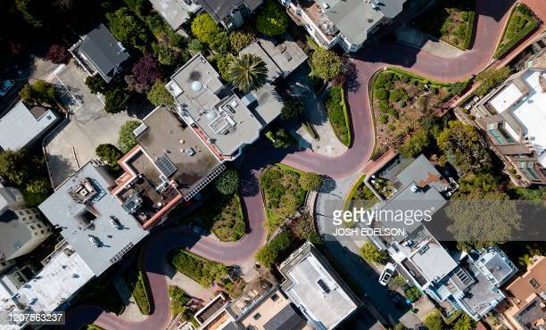 TOPSHOT The iconic twisty curves of Lombard Street are seen totally empty from above in San Francisco California on March 17 2020 San Francisco along...