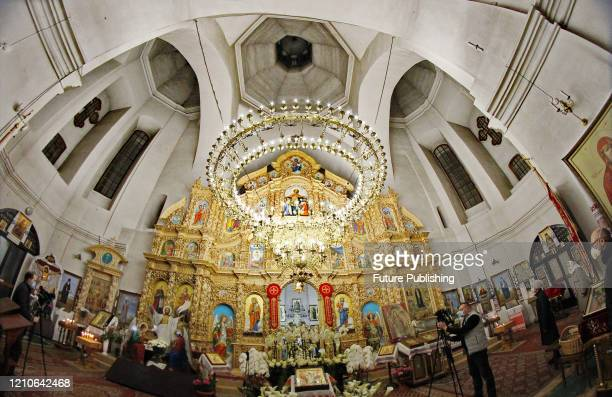 The iconostasis and the chandelier are seen inside St. Catherine's Church during a service on Holy Saturday, Chernihiv, northern Ukraine. -...