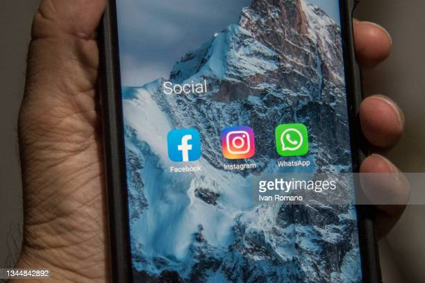 The icons of Facebook, Instagram, and Whatsapp are seen on a mobile phone on October 05, 2021 in Salerno, Italy. On 4 October, a Facebook outage...