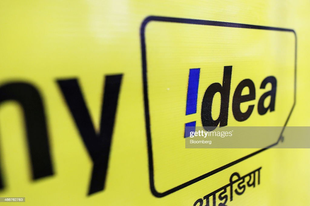 The Idea Cellular Ltd. logo is displayed at a store in Mumbai, India, on Wednesday, Jan. 29, 2014. India got bids totaling 446.1 billion rupees ($7.12 billion) on the first day of a wireless spectrum auction on Feb. 3, the third effort by the government to raise revenue from the sale of airwaves in the last 15 months. Photographer: Dhiraj Singh/Bloomberg via Getty Images