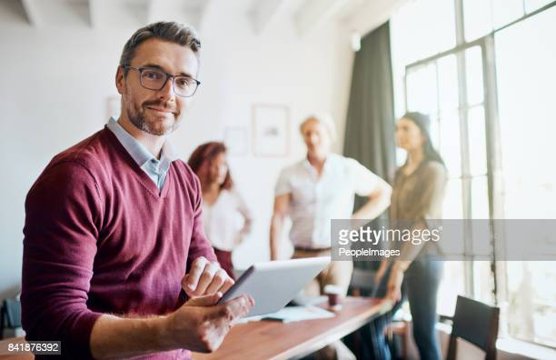 the ideas fly around in the office - bold man stock photos and pictures