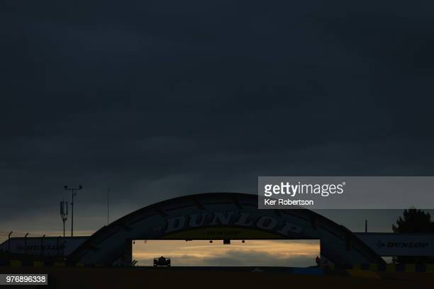 The IDEC Sport Oreca 07 of Paul Lafargue Paul Loup Chatin and Momo Rojas drives under the iconic Dunlop Bridge at dawn during the Le Mans 24 Hour...
