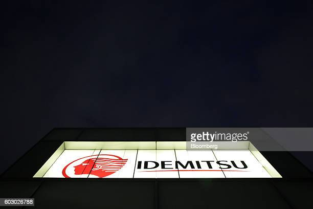 The Idemitsu Kosan Co logo sits illuminated atop one of the company's gasoline stations at night in Tokyo Japan on Friday Aug 12 2016 At an Idemitsu...