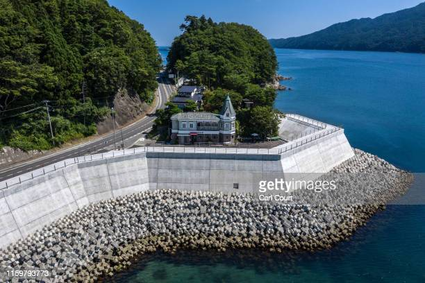 The Ijinkan cafe sits behind a newly-built concrete seawall in Miyako, one of the towns hit by the 2011 Tohoku earthquake and tsunami, on August 02,...