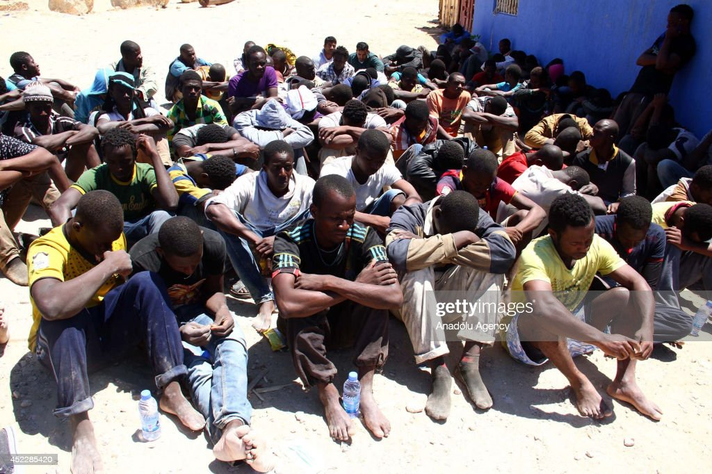 The illegal immigrants who rescued by Libyan coastguard after their boat started to sink off the coastal town of Garabulli in Tripoli, Libya, on July 17, 2014. Almost 100 immigrants are rescued and 4 killed after their boat is sinked off.