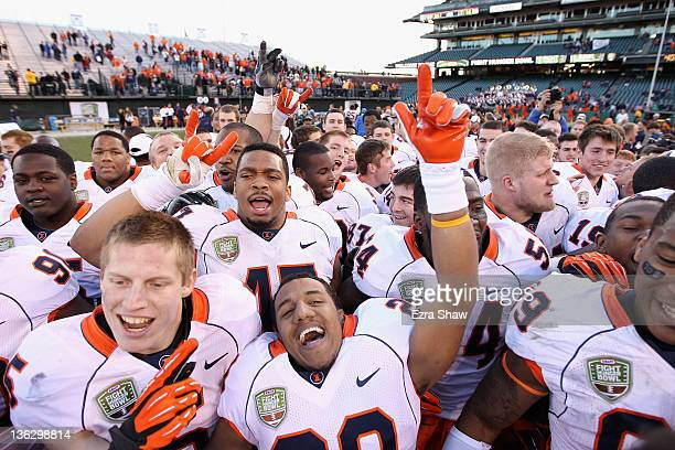 The Illinois Fighting Illini celebrate after they beat the UCLA Bruins in the Kraft Fight Hunger Bowl at AT&T Park on December 31, 2011 in San...