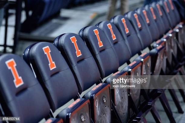 The Illinois Fighting Illini logo is seen on courtside seats before the start of the college basketball game between the Marshall Thundering Herd and...