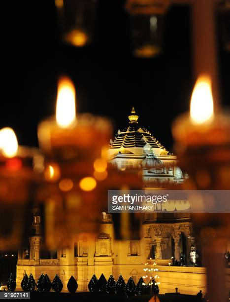 The illuminated Akshardham Temple is seen during Diwali in Gandhinagar some 30 kms from Ahmedabad on the occasion of Diwali on October 17 2009 The...