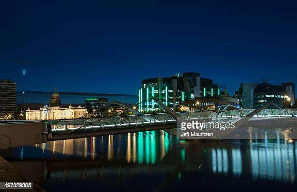 The illuminated Custom House reflects on the River Liffey at night.