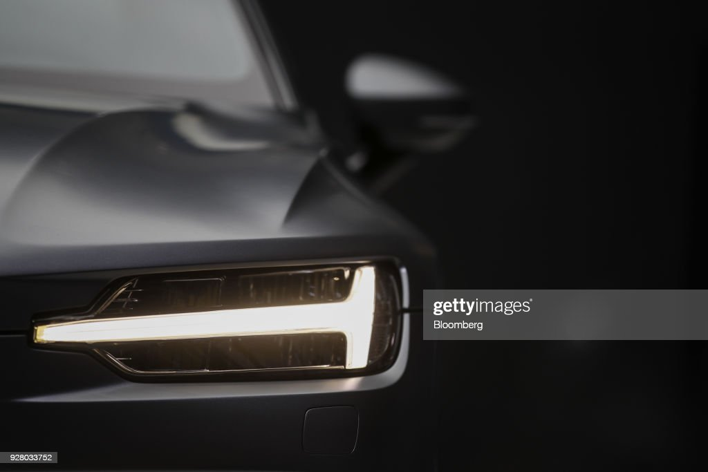 The illuminated headlight sits on a Polestar 1 electric automobile, manufactured by Volvo, on the opening day of the 88th Geneva International Motor Show in Geneva, Switzerland, on Tuesday, March 6, 2018. The show opens to the public on March 8, and will showcase the latest models from the world's top automakers. Photographer: Stefan Wermuth/Bloomberg via Getty Images