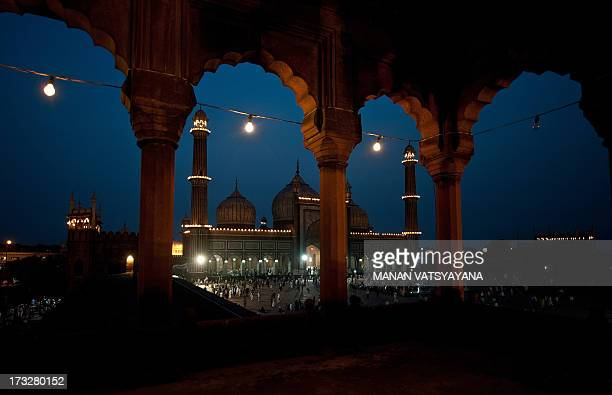 The illuminated Jama Masjid Mosque is pictured on the first day of the holy Islamic month of Ramadan at the Jama Masjid Mosque in New Delhi on July...