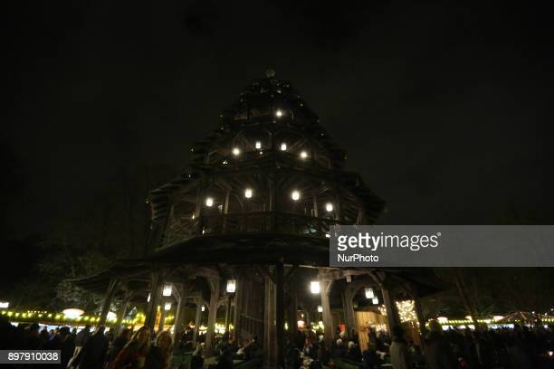 The illuminated quotChinesischer Turmquot Last Day of the Christmas Market at quotChinesischer Turmquot in Munich on December 23 2017