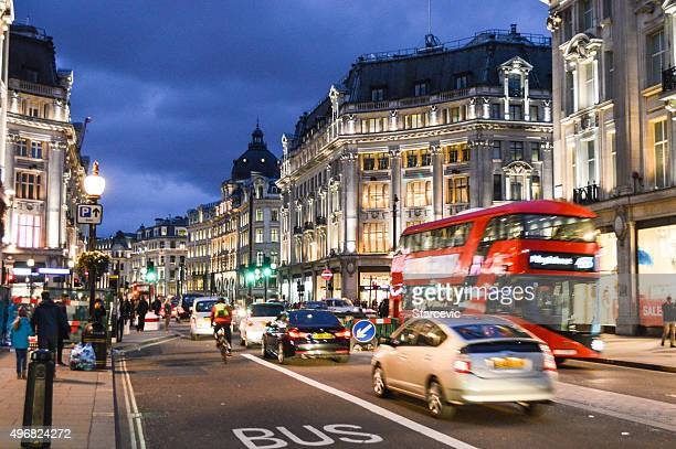the illuminated streets of london in the evening - oxford street london stock photos and pictures