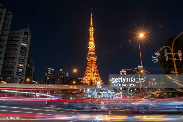 The illuminated Tokyo Tower is seen before the Earth Hour in Tokyo on March 27, 2021.