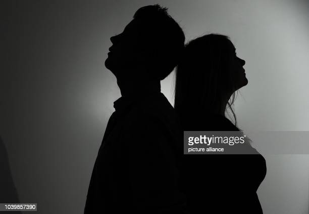 The illustration shows the silhouette of a woman and man standing backtoback to each other in Berlin Germany 8 January 2013 Photo JanPhilipp Strobel...