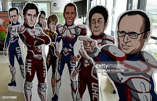 The illustrations of herostyle G7 leaders are on display by a NGO the Partnership for Material newborn and Child Health to demand the leaders to be...