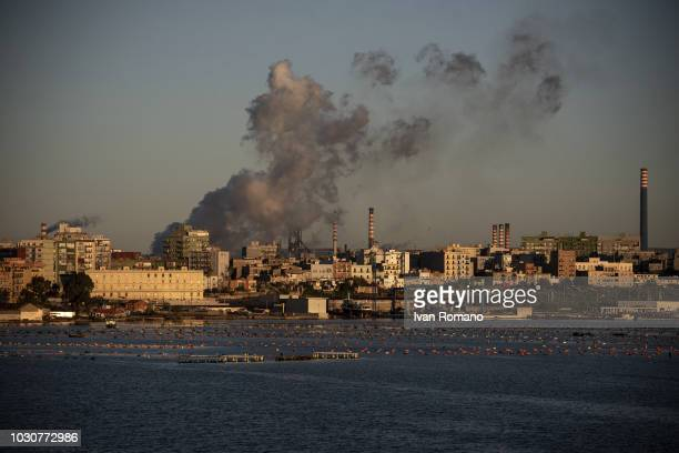 The Ilva steel plant during processing with the Tamburi district and mussel farms on December 10 2017 in Taranto Italy The Ilva steel plant of...
