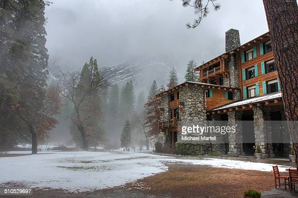 The image depicts the Yosemite Ahwahnee Lodge in the winter Low clouds surrounded the valley that cool evening when the image was shot Interesting...