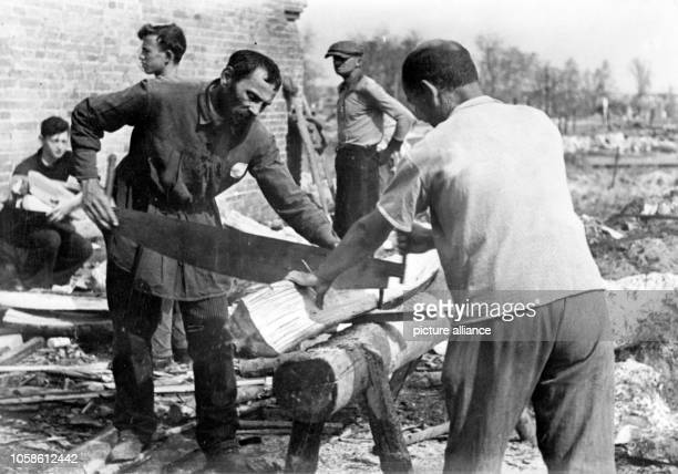 The image from the Nazi news report shows Jews working in the areas of the East Front occupied by the German Wehrmacht in September 1941 A...