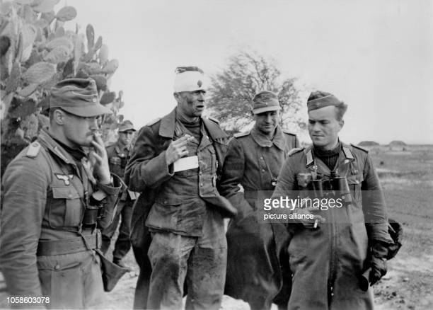 The image from the Nazi Propaganda depicts German soldiers reviewing the situation in North Africa published on 15 February 1942 Place unknown The...