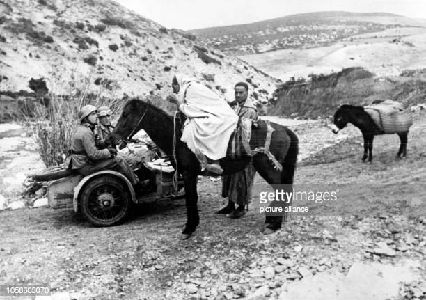 The image from the Nazi Propaganda depicts soldiers of the German Wehrmacht talking to locals in Tunisia published 4 February 1943 Place unknown...