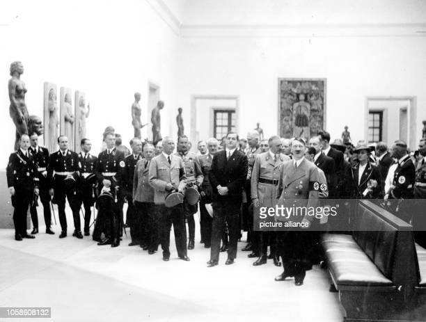 The image from the Nazi Propaganda shows Adolf Hitler after the opening celebrations of the Große Deutsche Kunstausstellung taking a tour thorugh the...