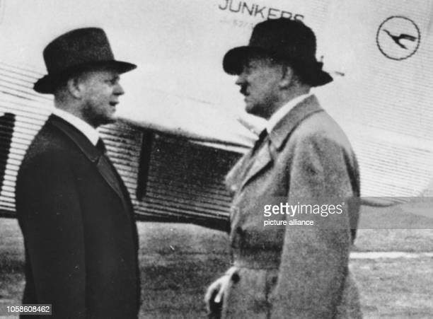 The image from the Nazi Propaganda shows Adolf HItler and the Director of the Deutsche Luft Hansa AG Erhard Milch in front of a Junkers Ju 52/3 with...