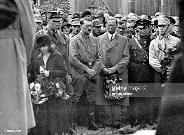 The image from the Nazi Propaganda shows Adolf Hitler attending the funeral of SA member Herbert Gatschke who was killed in a gunfight with a...