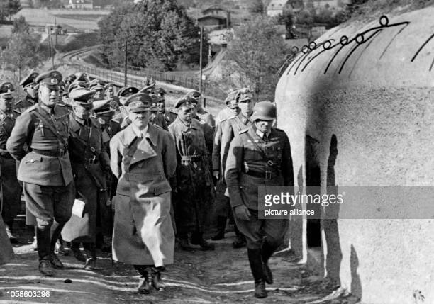 The image from the Nazi Propaganda shows Adolf HItler visiting a Czech bunker near the village Neuerbersdorf in Sudetenland in early October after...