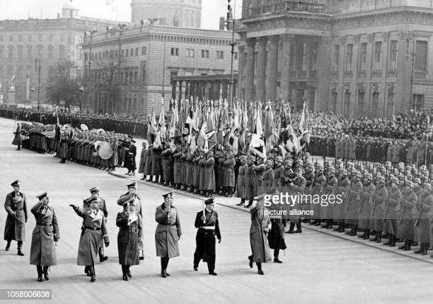 The image from the Nazi Propaganda shows Adolf Hitler walking past an honorary company after the ceremony in the yard of the Zeughaus in Berlin...