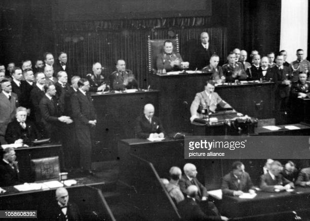 The image from the Nazi Propaganda shows Reich Chancellor Adolf Hitler delivering a speech to the Reichstag in the Kroll Opera House in Berlin...